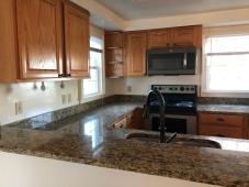 Kitchen has undergone a more modern renovation